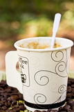 Paper cup of black coffee and coffee bean Stock Photo