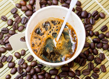 Paper cup of black coffee and coffee bean Royalty Free Stock Photo