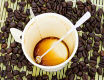 Paper cup of black coffee and coffee bean Royalty Free Stock Image