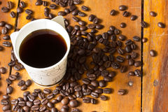 A paper cup of black coffee on table Royalty Free Stock Photography