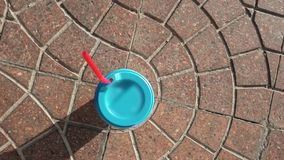 Paper cup with blue sealing cap and red straw stock video footage