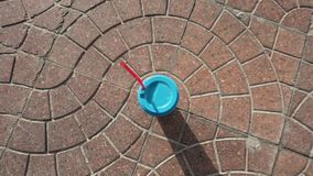 Paper cup with blue sealing cap and red straw stock video