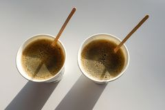 2 paper Cup boxes are on the table in the cafe. Coffee to go. Morning royalty free stock images