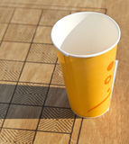 Paper cup on chess board Stock Photography