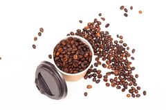 Paper cup with coffee beans isolated on white background.  royalty free stock photo