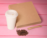 Paper cup,coffee beans,sugar and box. Royalty Free Stock Photos
