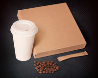 Paper cup,coffee beans,sugar and box. Stock Photography