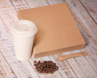 Paper cup,coffee beans,sugar and box. Royalty Free Stock Photo