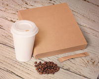 Paper cup,coffee beans,sugar and box. Stock Images