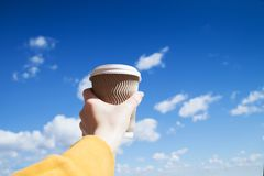 Paper cup of coffee in female hand royalty free stock photos