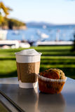 Paper cup with coffee and muffin Stock Photography