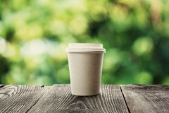 Paper cup of coffee. On natural background Stock Photography