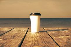 Paper cup with coffee Royalty Free Stock Photo