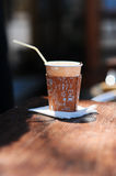 Paper cup with coffee. On table outdoors Royalty Free Stock Photo