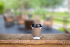 Paper cup of coffee on Wood table Royalty Free Stock Images