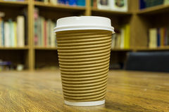 Paper cup of coffee on wooden table Royalty Free Stock Images