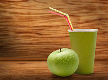 Paper cup and green apple Royalty Free Stock Photo