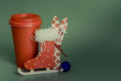 Paper Cup For a merry Christmas with skis skates. happy new year 2019 stock photo