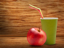 Paper cup and red apple Royalty Free Stock Photography