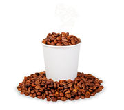 Paper cup of steaming coffee beans Stock Images