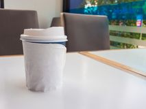 Paper cup of takeaway coffee on the table, Place for your text o. R logo Stock Images