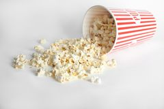 Paper cup with tasty popcorn Royalty Free Stock Images