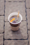 Paper cup of tea. With orange Royalty Free Stock Image