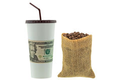 Paper cup wrapped with USD dollar banknote money next to hemp sa Stock Photo