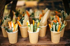 Paper cups of assorted vegetable platter - carrots, dill, orange, cucumber. Royalty Free Stock Photo