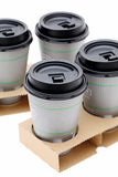 Paper cups of coffee in holder Stock Images