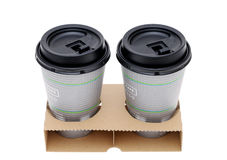 Paper cups of coffee in holder Stock Image