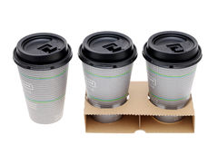 Paper cups of coffee in holder Stock Photos