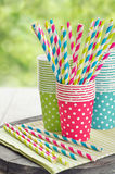Paper cups and striped straws royalty free stock images
