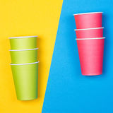 Paper cups on the Yellow and blue background. Minimalism Royalty Free Stock Photos