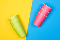 Paper cups on the Yellow and blue background. Minimalism Royalty Free Stock Image