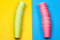 Paper cups on the Yellow and blue background. Minimalism Royalty Free Stock Images