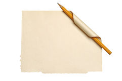 Paper with curled corner and pencil Royalty Free Stock Images