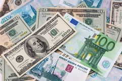 Paper currency background. Dollars, European and Russian money Royalty Free Stock Photos