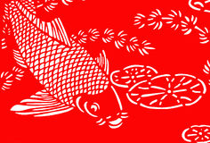 Paper-cut. The traditional paper-cut fish on the red Stock Photos