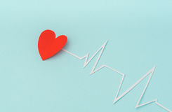 Paper cut of cardiogram of heart rhythm for Valentines Day . Stock Photo