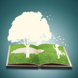 Paper cut of children play concept. Paper cut of children play on grass book concept Stock Images