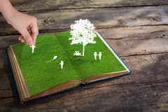 Paper cut of children play on green grass grass Royalty Free Stock Photo