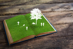 Paper cut of children play on green grass grass Stock Images