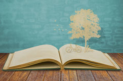 Paper cut of children read a book under tree stock photos