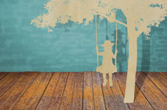 Paper cut of children on swing Royalty Free Stock Photos