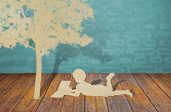 Paper cut of children under tree. royalty free stock photography