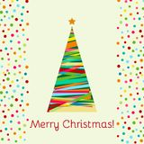 A paper cut Christmas tree on the light yellow background with confetti.. A paper cut Christmas tree on the light yellow background with confetti. Creative Stock Photo