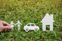 Paper cut of couple car and house on green grass Royalty Free Stock Photography