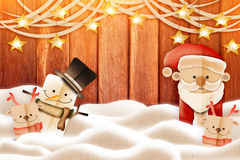 Paper cut deers snowman and santa on wooden background Stock Photography