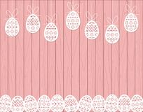 Paper cut Easter eggs hanging on pink Wooden background Royalty Free Stock Images